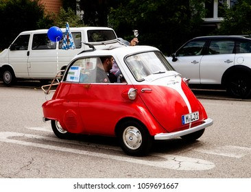 GARCHING, GERMANY-JULY 2, 2017. Vintage car BMW Isetta 300 at the traditional Parade for the 46. Citizen Week (Buergerwoche) in Garching universitary town near Munich