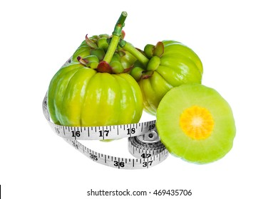 Garcinia cambogia fresh fruit with measuring tape, isolated on white background. Garcinia atroviridis is spice plants. It helps in the metabolism contain high vitamin C and hydroxy citric acids (HCA)