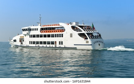GARDA, LAKE GARDA, ITALY - SEPTEMBER 2018: The passenger ferry Andromeda leaving the town of Garda on Lake Garda.
