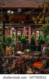 Garden arbor made of wood, natural wood, shadow protection from sunlight, garden furniture, fruits on the table.