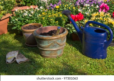 Garden with autumn flowers in September - Planting new plants in flowerpots and -boxes