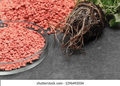 Garden background with mineral fertilizers balls. Complex mineral fertilizer with sodium, phosphorus for flowers, plant, tree