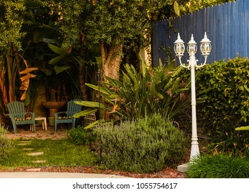 Garden Backyard With Chairs and Light Post