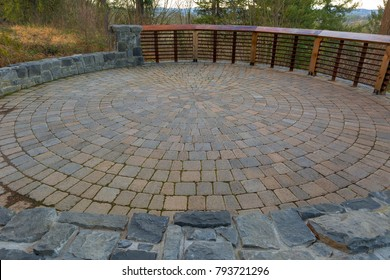 Garden Backyard circular brick stone pavers hardscape patio with wood railings stone wall landscaping