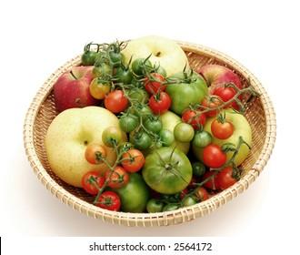 a garden basket: tomato and apple