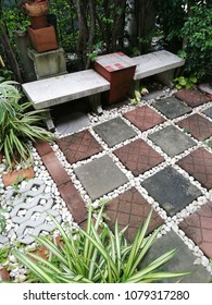 garden bench and stone path