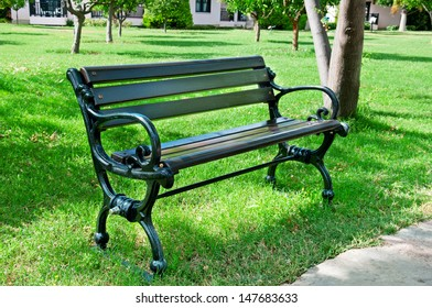 Garden bench in a summer park