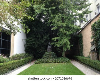 a garden with a bust of Beethoven
