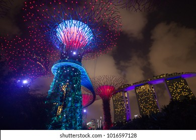Garden by the Bay, Singapore, February 3, 2018: Light and sound event show at Garden by the Bay featuring beautiful light show on the Supertrees