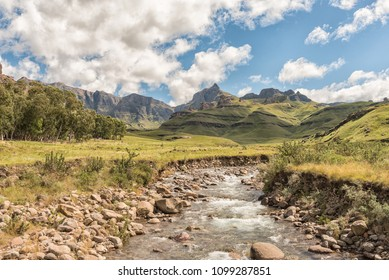 Garden Castle in the Drakensberg near Underberg. Hermits Wood Camp Site is visible between the trees and the Mlambonja River in front. Rhino Peak (3056m) is visible in the back