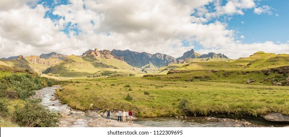 GARDEN CASTLE, SOUTH AFRICA - MARCH 25, 2018: Garden Castle in the Drakensberg. Hermits Wood Camp Site is visible between the trees in the back and the Mlambonja River in front. People are visible