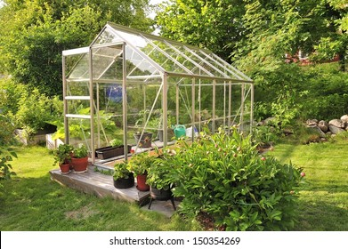 A garden center greenhouse with a colorful display of potted plants and flowers