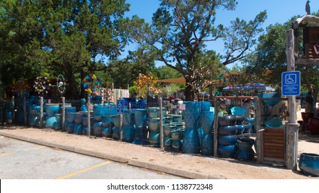 a garden center with a row of turquoise pots for the yard