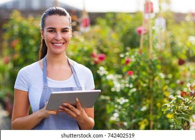 Garden center worker using digital tablet