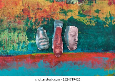 Garden ceramic sacred faces Still Life Photography on abstract green background
