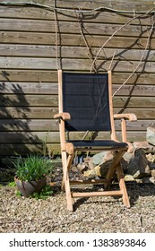 Garden chair in early spring garden