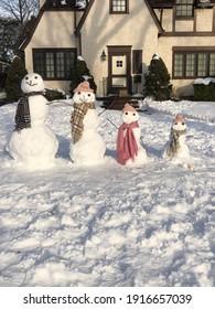 Garden City, New York, USA: February 13, 2021: Snowman Family