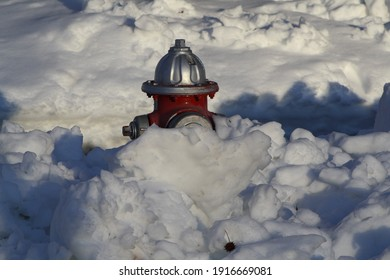 Garden City, New York, USA - February 4, 2021: Fire Hydrant Buried in Snow