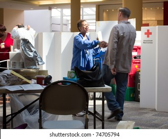GARDEN CITY, NY - APRIL 3, 2011:  In the wake of the devastation in Japan, American Red Cross blood drive for disaster relief in Garden City, New York in Roosevelt Field Mall.