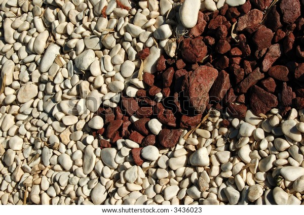 Garden decoration white and red pebbles
