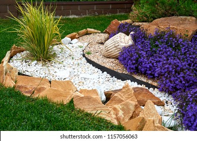Garden Design. Flowerbed in the yard in landscape design.