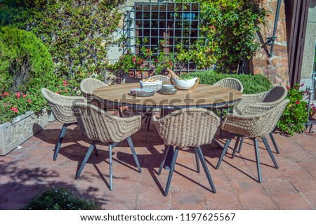 Surprising Garden Dining Table Chairs Stock Photo Edit Now 1197625567 Onthecornerstone Fun Painted Chair Ideas Images Onthecornerstoneorg