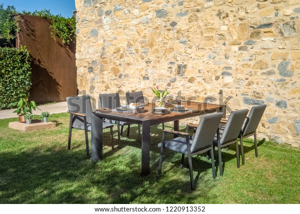Astounding Garden Dining Table Chairs Stock Photo Edit Now 1220913352 Onthecornerstone Fun Painted Chair Ideas Images Onthecornerstoneorg