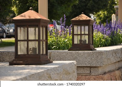 Garden entryway with lanterns lighting the way