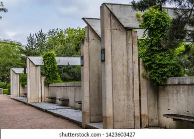 Garden Eugenie-Djendi (former Black Garden) - 2 hectares public parc between St. Charles Street (rue Saint-Charles) and Leblanc street (rue Leblanc) with a bushy vegetation. Paris, France.