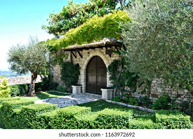 Garden and facade of an ancient house in the fortress of Berat