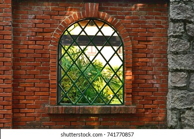 garden fence brick wall with window grills