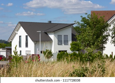 garden fence of modern house architecture in rural countryside at springtime in south germany near city stuttgart