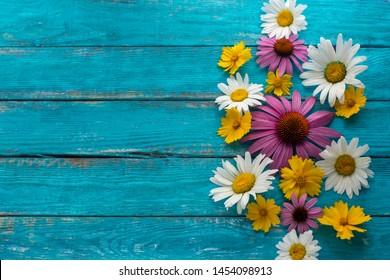 Garden flowers in turquoise wooden background