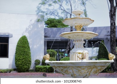 Garden fountains in park.Beautiful white and gold marble fountains day light. Fountain valley.Water fountains