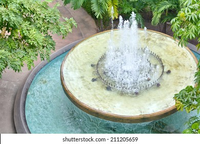 Garden fountains spray water around the area is moist and cool