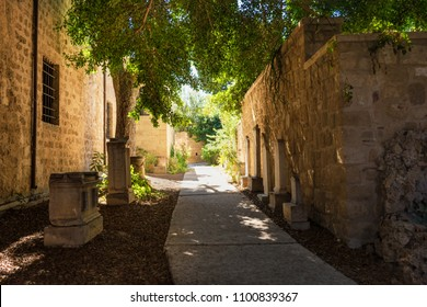Garden with fragments of medieval statues and tomb stones in old town in City of Rhodes (Rhodes, Greece)
