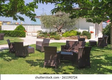 Garden furniture on lawn in courtyard a hotel spa