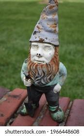 Garden gnome on a brick wall