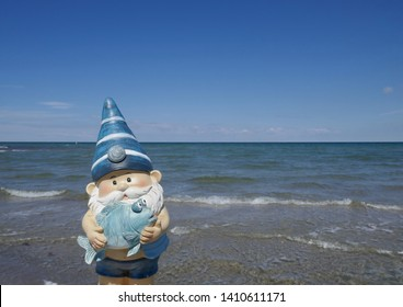 Garden Gnome is on vacation by the sea. (not protected by copyright)