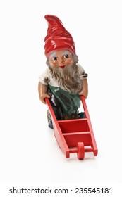 Garden gnome pushing wheel barrow
