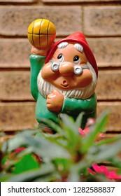 A garden gnome in a garden standing