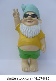 Garden gnome with sunglasses makes peace signs