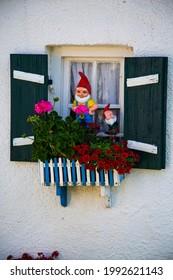 Garden gnome at the window, funny garden gnome