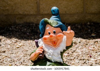 Garden Gnome with yellow background and blue hat
