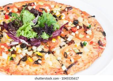 Garden Greens Pizza top with fresh mesclun mix