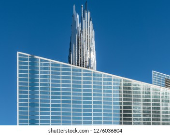 Garden Grove, California, USA - December 13, 2018: Crystal Christ Cathedral. Closeup of Church building and Crean Tower against blue sky.