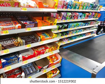 Garden Grove, California/United States - 09/20/2019: Impulse buys at the checkout lane, featuring candy bars and gum.