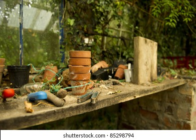 Garden implements and pots in potting shed.