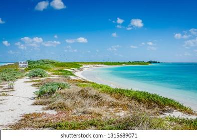 Garden Key, FL / USA - 02-09-2015: Beach and peninsula on Garden Key, closed seasonally for migrating bird nesting. Garden Key is one of the Florida islands forming Dry Tortugas National Park.