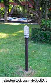 Garden lamp with green lawn